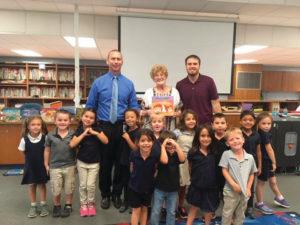Photos of children with the senior volunteers at the Orange City Elementary School